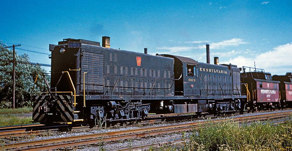 Three-quarter color photo of a transfer type diesel locomotive.