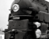 Black-and-white photo of front portion of 4-6-2 steam locomotive.