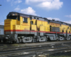 Broadside color photo of Union Pacific road-switcher diesel locomotive.