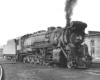Black-and-white three-quarter-angle photo of 2-10-2 steam locomotive.