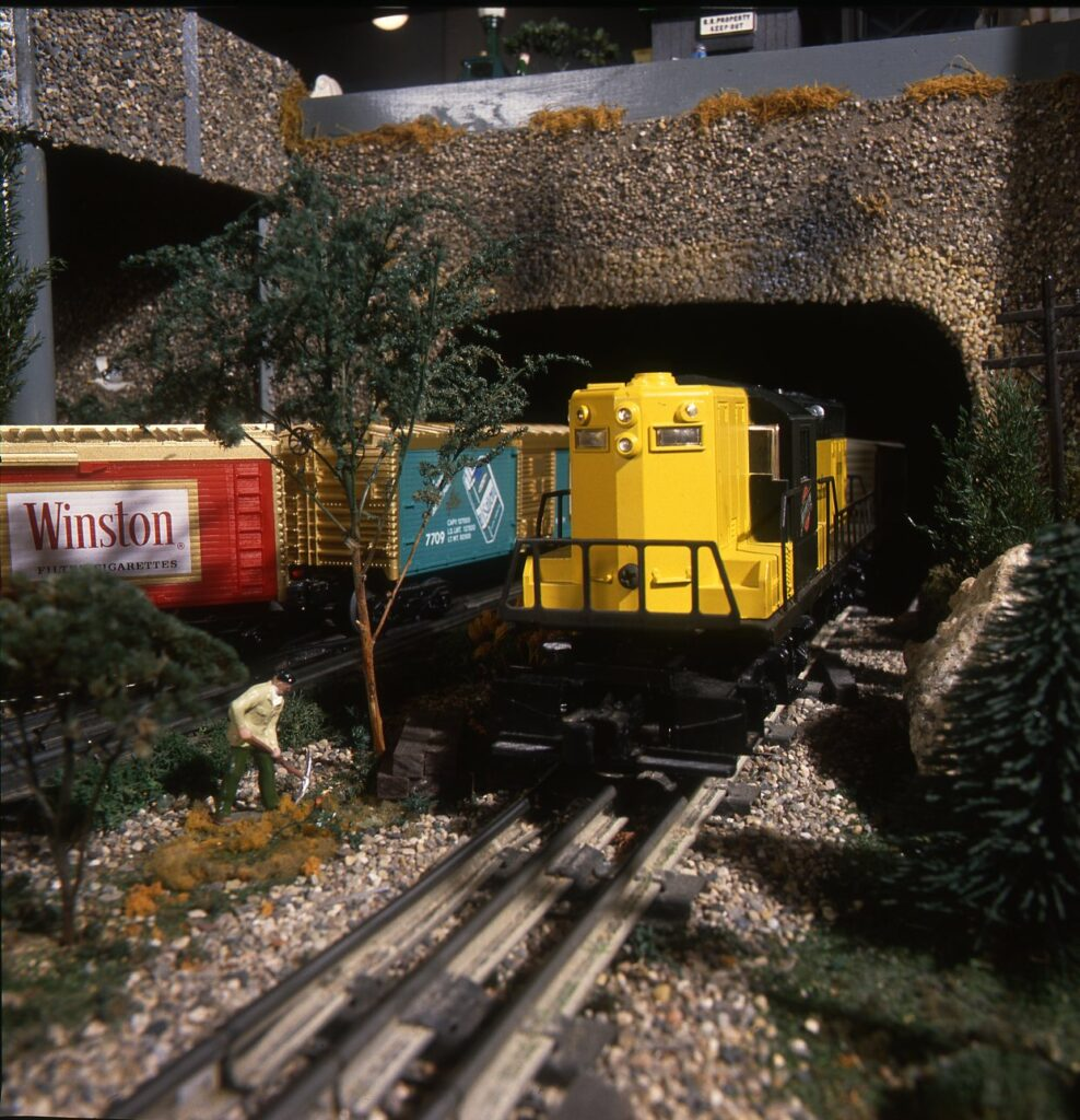 A Lionel diesel exiting a tunnel