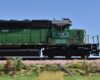 A green diesel locomotive bearing patched-out Wisconsin & Southern reporting marks rolls past motion-blurred scenery