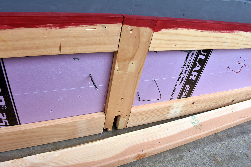 Bottom of layout surface, pink foam attached to 1 x 4 frame with wires poking out of surface