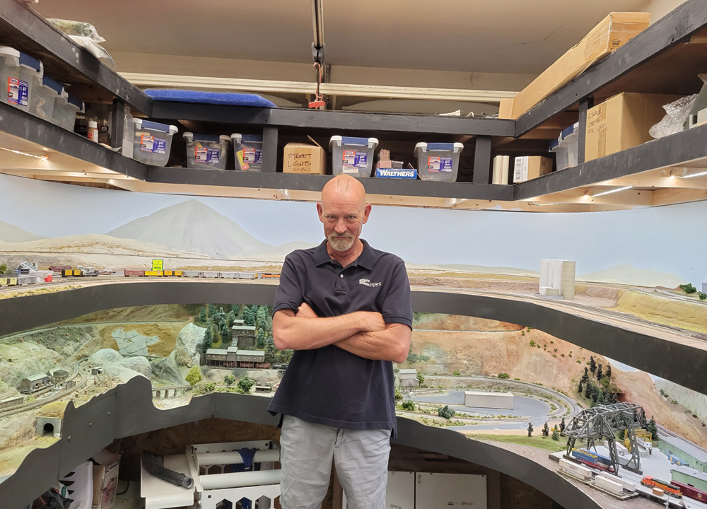 Steve Brown next to his layout