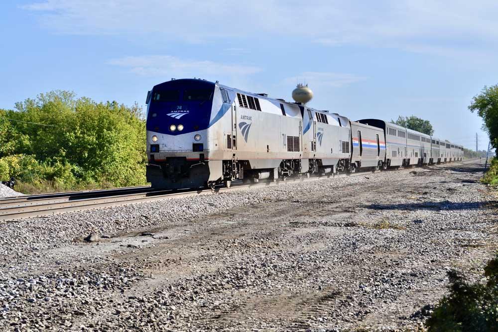 Two diesel locomotives on streamlined passenger train