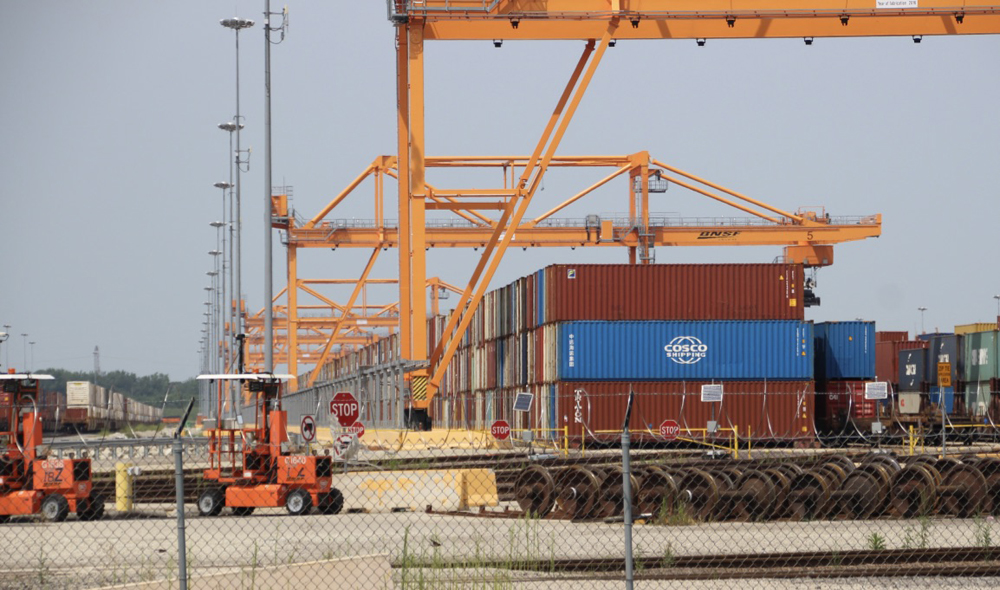 Containers stacked under cranes