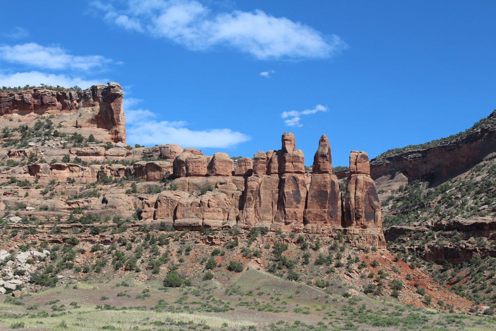 Red rock formations under blue skies