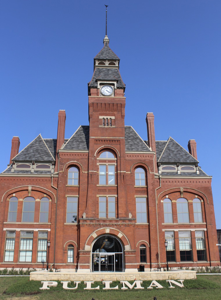 Multi-story brick building with center clock tower