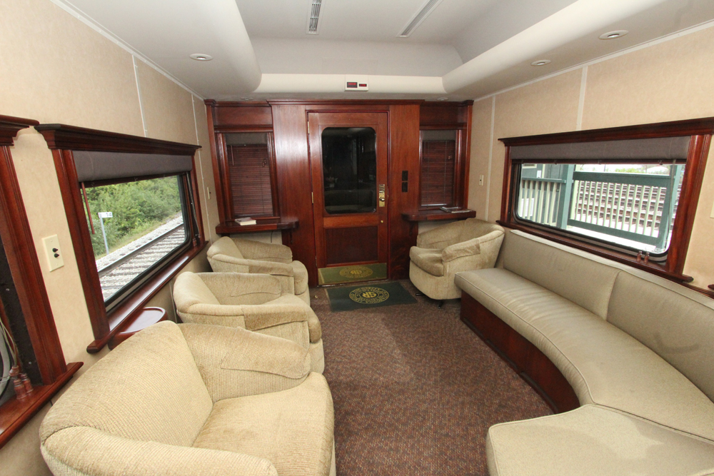 Chairs and sofas inside railroad car