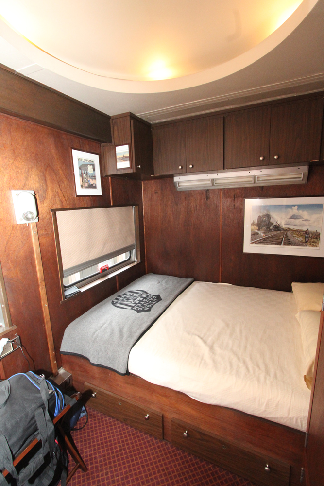 Wood-paneled bedroom with large bed