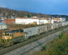 Color photo of road-switcher diesel locomotive with Reading Company freight train