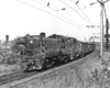 Black-and-white photo of two road-switcher diesel locomotives with Reading Company freight train