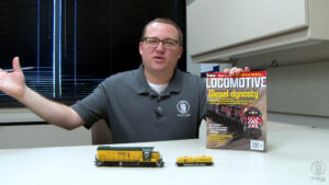 Cody Grivno with products in his office
