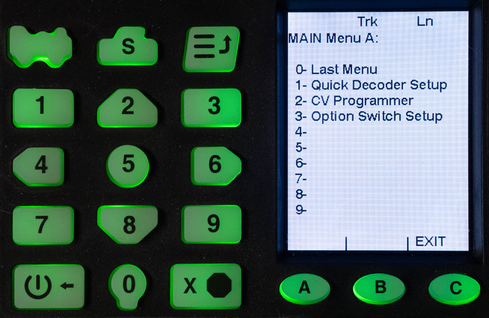 The keypad and display screen of a Digitrax DCC base station is seen during the process of programming a decoder.