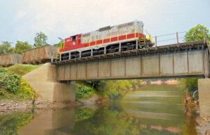 Model diesel locomotive on a bridge