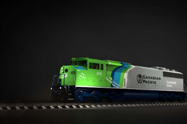 Green, blue, white, and gray carbody locomotive.