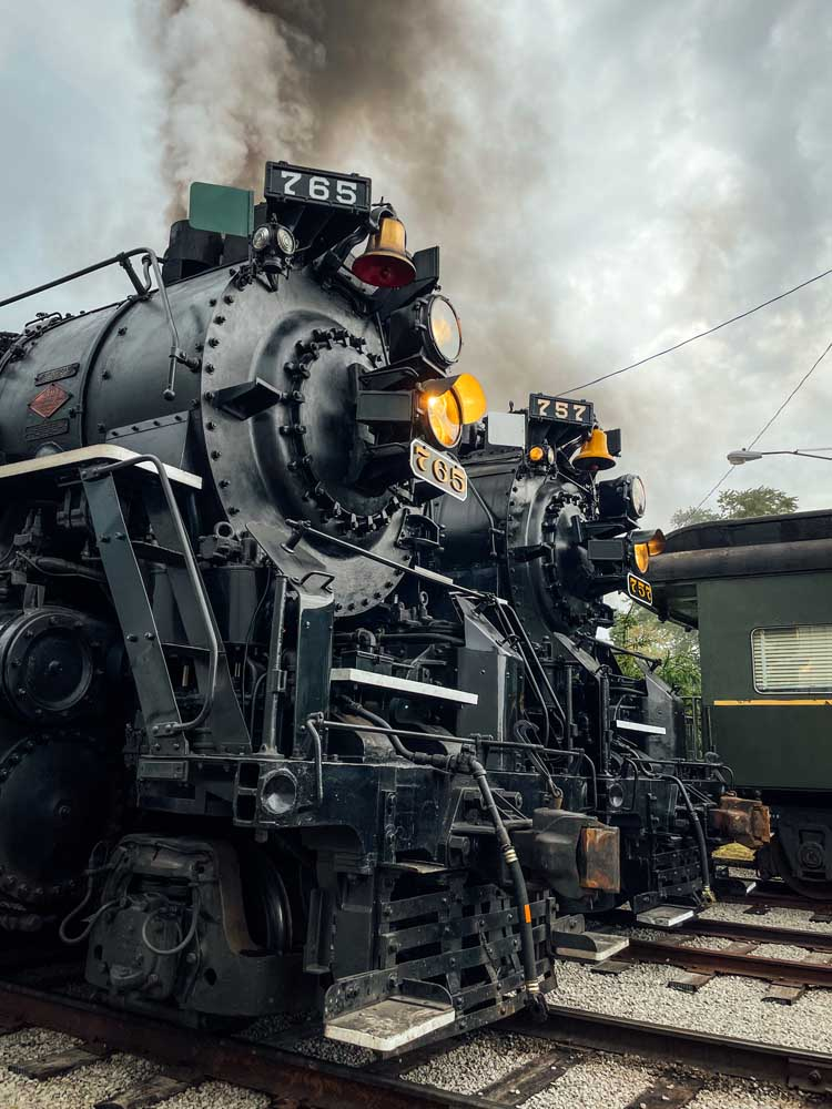 Two steam locomotives lined up side-by-side