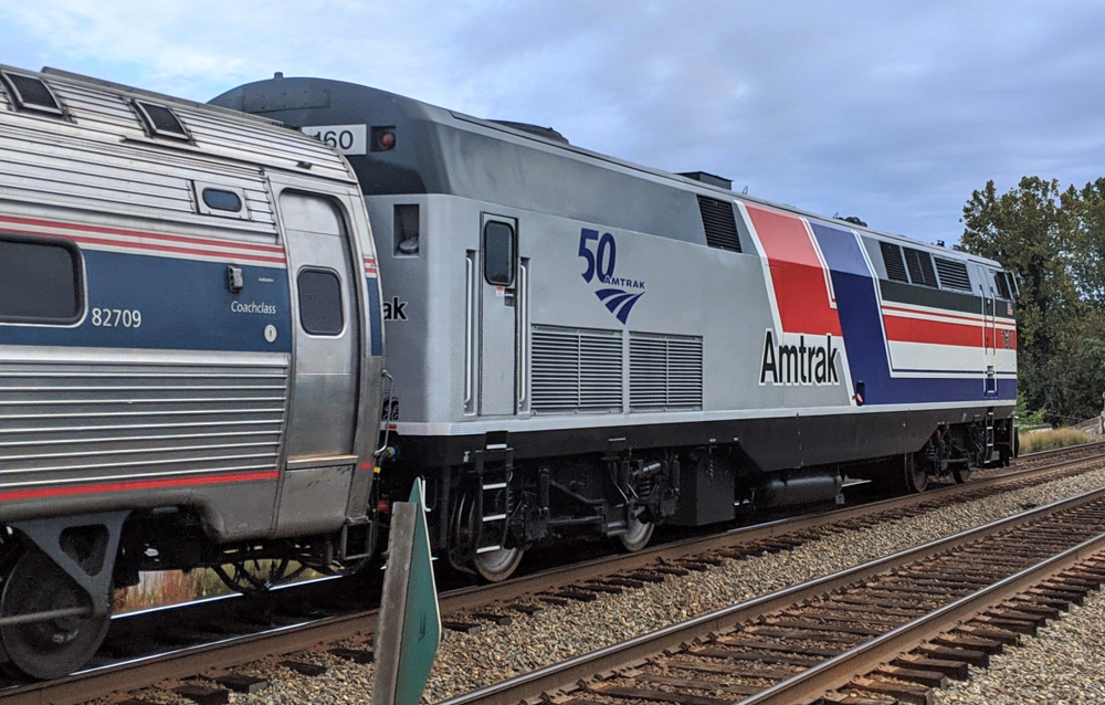 Rear view of locomotive with red, white, and blue stripes